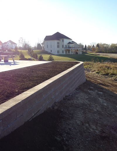 retaining wall installation services by Greenfield Landscaping
