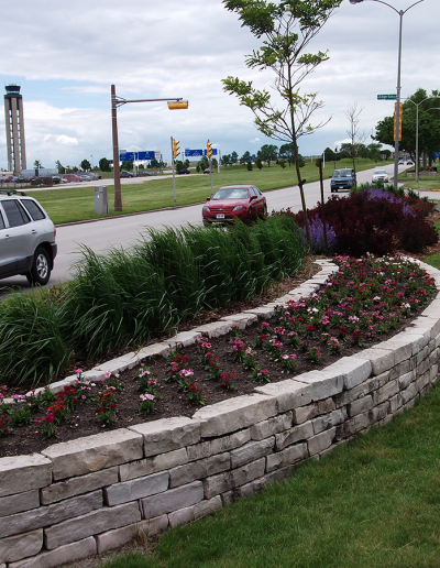 retaining wall installation and planting services by Greenfield Landscaping